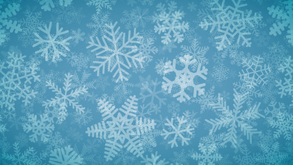 Christmas background of many layers of snowflakes of different shapes, sizes and transparency. White on light blue.