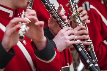 Clarinet musicians in red uniform