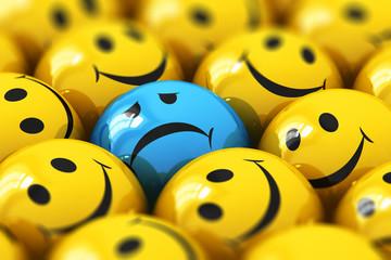 Single sad blue smiley among happy yellow ones