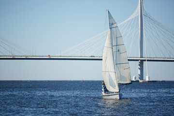 Active man sailing on yacht in the sea while enjoying summer vacation