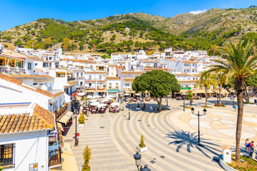 Poster de jardin Europe Méditérranéenne MIJAS VILLAGE, SPAIN - MAY 9, 2018: Main square with houses in picturesque white village of Mijas, Andalusia. Southern Spain is famous for mountain villages with white architecture.