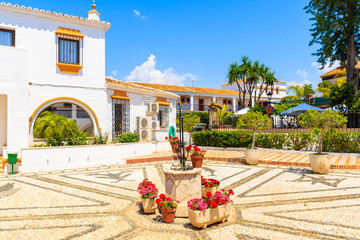 Square with flowerpots in front of a typical house in small village near Marbella. Andalusia, Spain