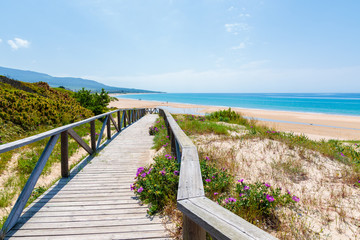 Wooden coastal promenade along Bolonia beach, Andalusia, Spain