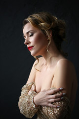 Portrait of young beautiful blonde with makeup and rings