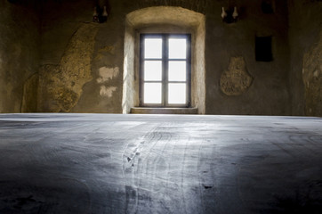 Fortress Brasov inside room table and windw dark