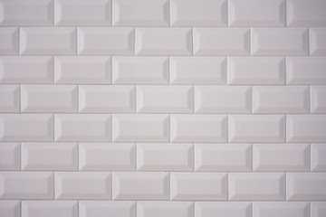 Ceramic rectangular white tile laid horizontally. Glazed white ceramic brick for interior walls