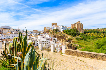 View of beautiful white village with church on hill, Sentinel de las Bodegas, Andalusia, Spain