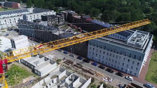 Aerial flight around tower crane a modern form of balance crane that