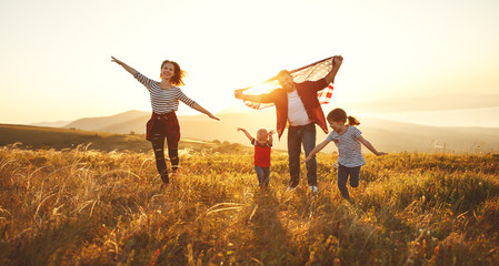 happy family with flag of america USA at sunset outdoors Wall mural