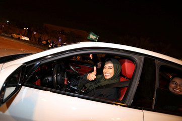 A Saudi woman drives her car in her neighborhood, in Al Khobar