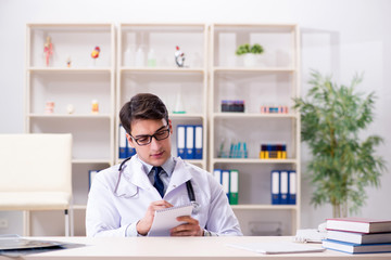 Young doctor sitting in the office