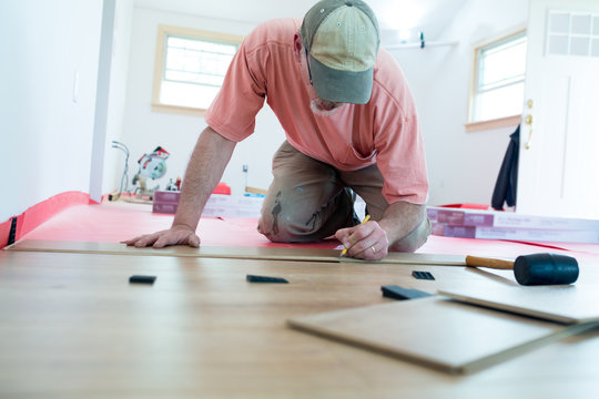 Homeowner measuring for DIY Laminate Floor installation