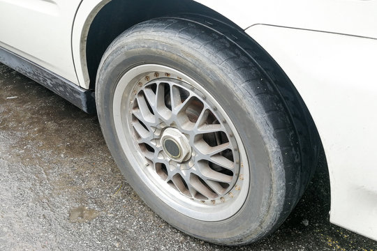 Car with worn bald tire unsafe and poses accident risk