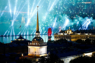 Fireworks are seen over the Admiralty building, the Peter and Paul cathedral and the State Hermitage museum during the festivities marking school graduation in St. Petersburg