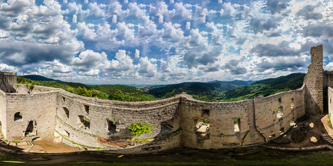 360-degree panoramic aerial view from drone to Vosges mountains and ruins of medieval castle Spesbourg, Andlau, Alsace.