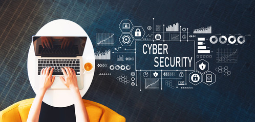 Cyber Security with person using a laptop on a white table