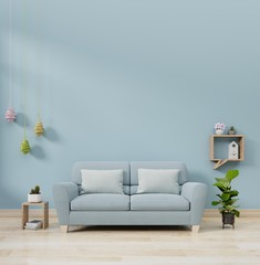 Modern living room interior with sofa lamp and green plants on blue wall background, 3d rendering.