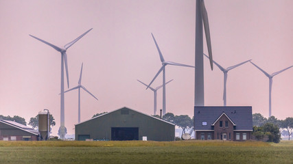 Modern farm in open countryside with wind turbines