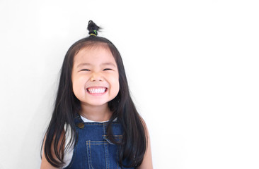 Asian children cute or kid girl and kindergarten student happy smile white teeth and laugh with wear dungarees jean for fashion on white background with space isolated Fotoväggar