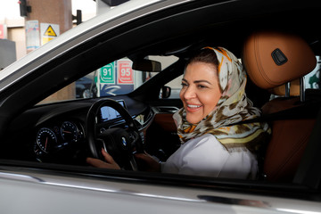 Dr Samira al-Ghamdi, a practicing psychologist, drives her car out in her neighborhood while going to work, in Jeddah