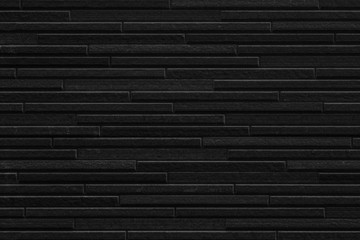 Modern black stone tile wall pattern and seamless background