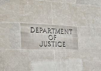 Department of Justice sign on Building Wall