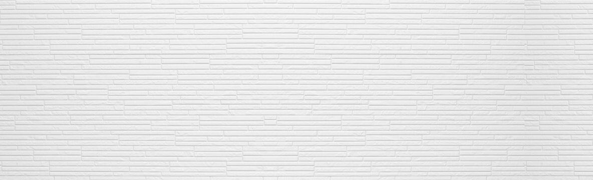 Panorama of Modern white stone wall pattern and background