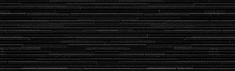 Panorama of Modern black stone tile wall pattern and seamless background