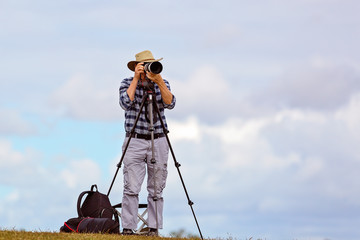 A Senior Male Photographer Pursuing His Hobby In Retirement