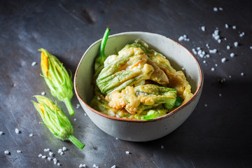 Homemade and tasty roasted zucchini flower served with salt