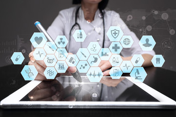 Medical doctor working with modern computer virtual screen interface. Medicine technology and healthcare concept. EMR, EHR, Electronic Health Records.