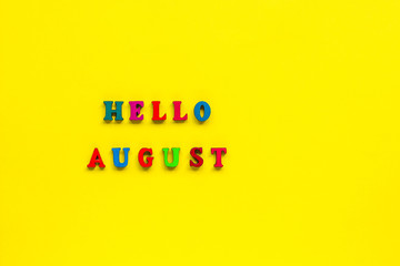 Text Hello August from colorful letters, yellow background