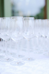 Many empty wineglasses on table. Concept of wine and tableware.