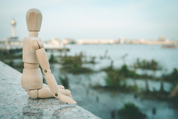 wooden dummy have feeling happiness on river view blur concept.