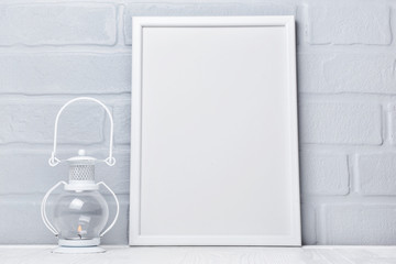 Decorative lantern and mock-up of white frame with copy space for poster