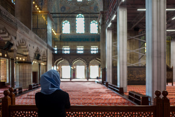 Woman in the Sultan Ahmed Mosque in Istanbul, Turkey.
