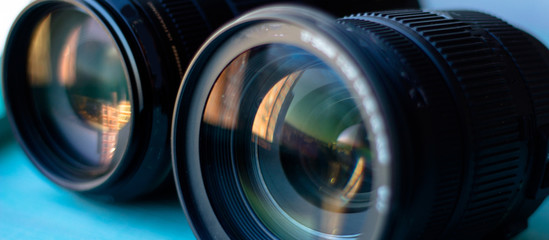 Camera lens with bokeh lights background, banner for website