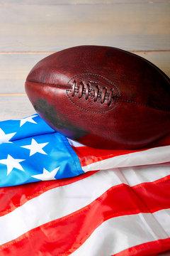 American football ball and old glory flag..