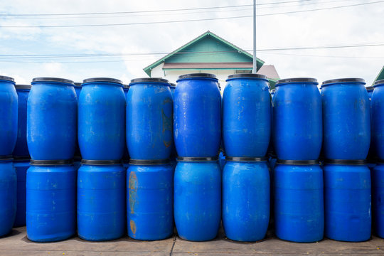 Old blue wide open plastic tanks for factory packing.