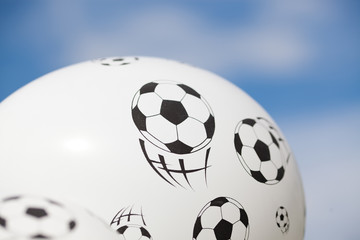 balloon with footballs against blue sky - soccer supporter - world cup