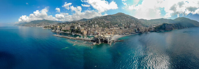 Foto auf Leinwand Kuste Aerial View of Camogli town in Liguria, Italy. Scenic Mediterranean riviera coast. Historical Old Town Camogli with colorful houses and sand beach at beautiful coast of Italy.