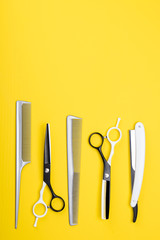 a set of tools and items for hair care, and haircuts, on a yellow background