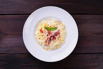 Pasta carbonara with ham and parmesan cheese. Traditional Italian meals, restaurant menu concept