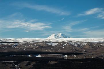 The top of Mount Elbrus on the horizon