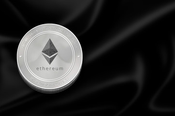 Ethereum (ETH) digital crypto currency. Stack of black and silver ether coins. Cyber money.