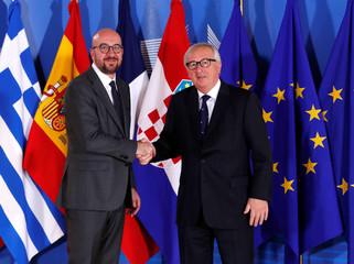 Belgian PM Michel is welcomed by European Commission President Juncker at the start of an emergency European Union leaders summit on immigration at the EU Commission headquarters in Brussels