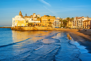 Sand beach and historical Old Town in mediterranean resort Sitges, Spain