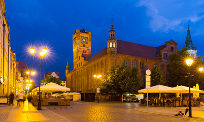 Torun Town Hall and statue of Copernicus in evening
