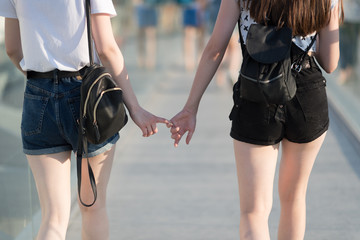 Girl holding hands at the big city
