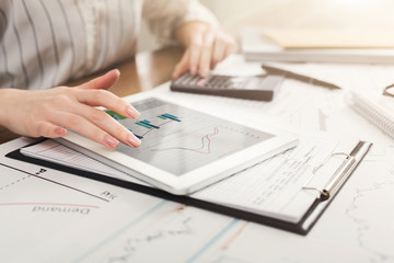 Calculator and financial charts on workplace